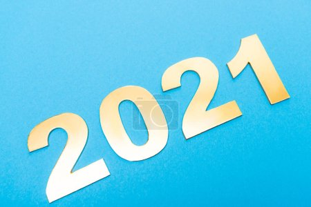 Photo for Top view of 2021 numbers on blue background - Royalty Free Image