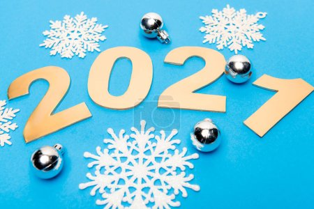 Photo for New year decoration and 2021 numbers on blue background - Royalty Free Image