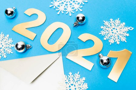 Photo for New year decoration, envelope and 2021 numbers on blue background - Royalty Free Image