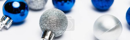 blue, silver Christmas decoration on white background, banner