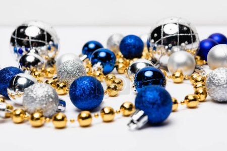 Photo for Blue, silver and golden Christmas decoration on white background - Royalty Free Image