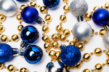 Photo for Top view of blue, silver and golden Christmas decoration on white background - Royalty Free Image