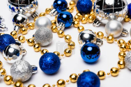 blue, silver and golden Christmas decoration on white background