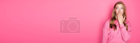 Photo for Shocked beautiful woman covering mouth on pink background, banner - Royalty Free Image