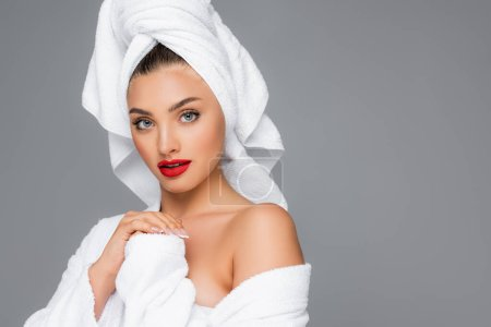 woman with towel on head and red lips isolated on grey