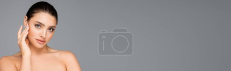 beautiful woman posing isolated on grey, banner