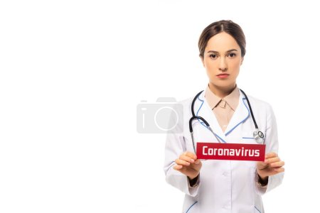 Photo for Doctor in white coat holding card with coronavirus lettering isolated on white - Royalty Free Image