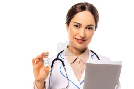 Doctor with vaccine and paper folder smiling at camera isolated on white