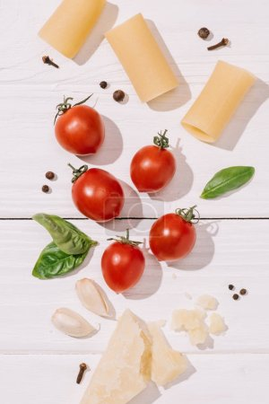 top view of various italian food on white wooden tabletop