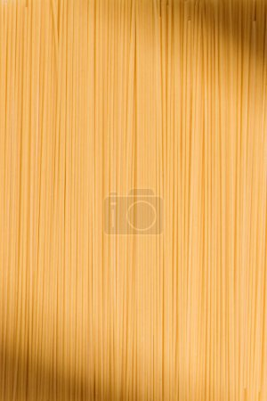 full frame shot of uncooked traditional spaghetti