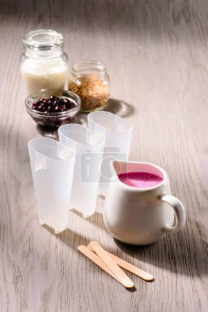 Ingredients for cooking berry ice pops on wooden background