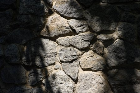 full frame image of stone wall with sunlight background