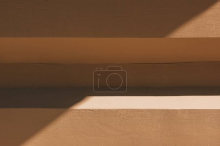 full frame image of facade of building with sunlight background