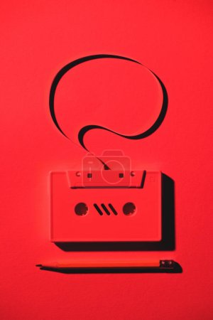 toned red picture of pencil and retro audio cassette with speech bubble