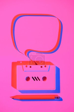 toned pink picture of pencil and retro audio cassette with speech bubble