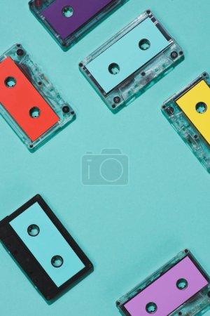 flat lay with arranged colorful retro audio cassettes isolated on blue