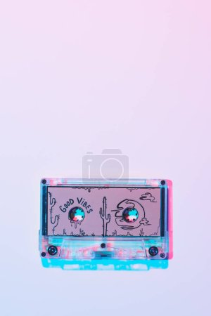 top view of mixtape with good vibes inscription on purple background