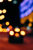 close up view of colorful bokeh night city lights on dark background