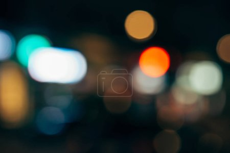 Photo for Close up view of colorful bokeh lights on dark background - Royalty Free Image
