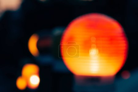 close up view of colorful bokeh lights and blurred city lantern on dark background