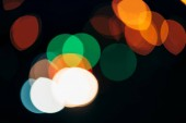 close up view of colorful bokeh lights on dark background