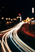 blurred view of night city street and city lights