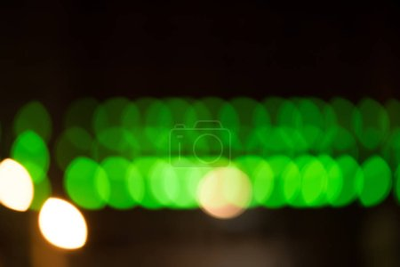 green bokeh city night lights on black background