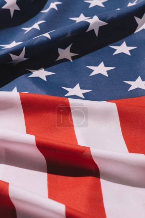 close up view of folded american flag background