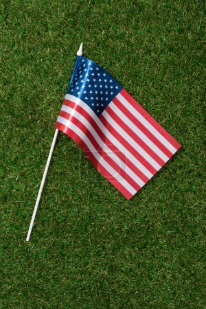 top view of american flagpole on green grass, americas independence day concept