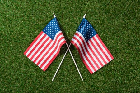 Photo for Top view of arranged american flagpoles on green grass, 4th july holiday concept - Royalty Free Image