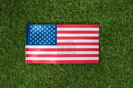 top view of american flag on green grass, 4th july holiday concept