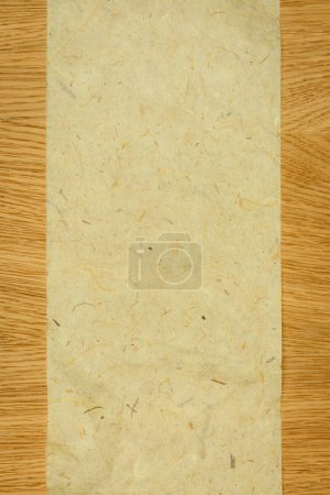 elevated view of blank chipboard on wooden table