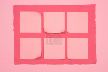elevated view of empty stick it notes on pink frame