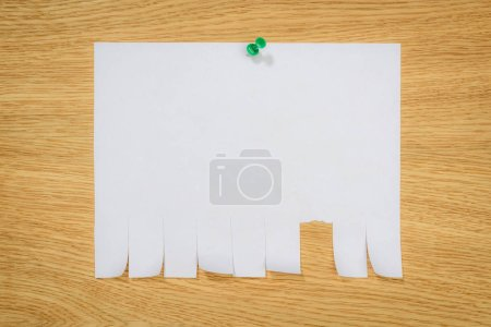 top view of empty paper for ads with drawing pin on wooden board