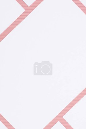 top view of empty white papers on pink