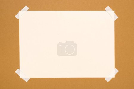 top view of blank white paper on beige
