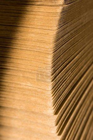selective focus of stack of cardboard papers