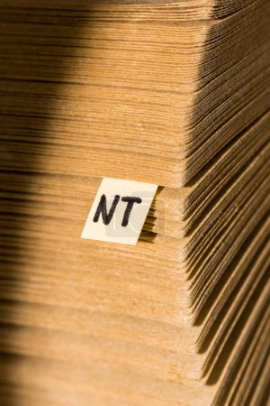 close up view of stack of cardboard papers and note with lettering nt