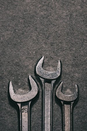 top view of metal wrenches on grey surface