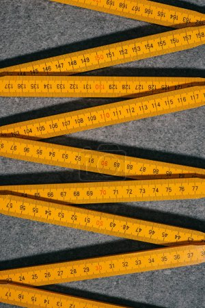Photo for Elevated view of collapsible meter on grey surface - Royalty Free Image