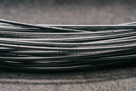 Photo for Selective focus of grey wires on tabletop - Royalty Free Image
