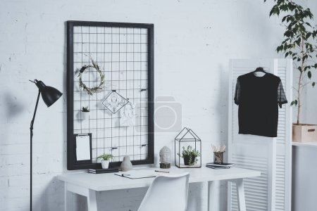 working office table with office supplies and plants
