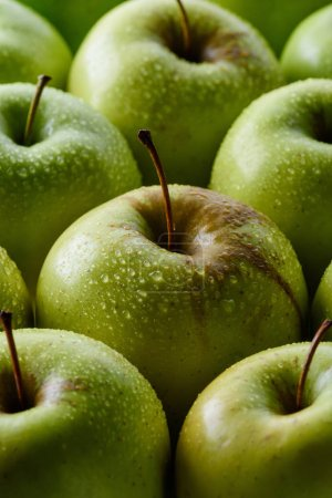 Photo for Close up view of water drops on fresh green apples backdrop - Royalty Free Image