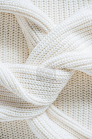 close up view of twisted sleeves of white woolen sweater