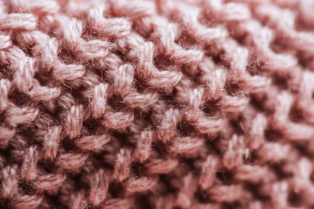 full frame image of pink woolen fabric background