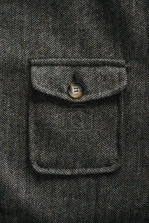close up view of grey woolen pocket with button