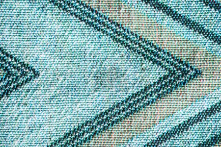 full frame image of textile fabric with abstract pattern background