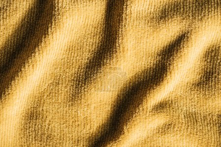 full frame image of yellow crumpled terry fabric background