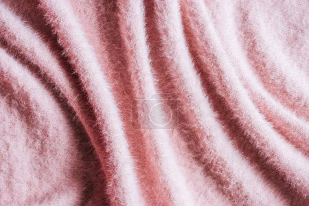 full frame image of pink fluffy woolen fabric background