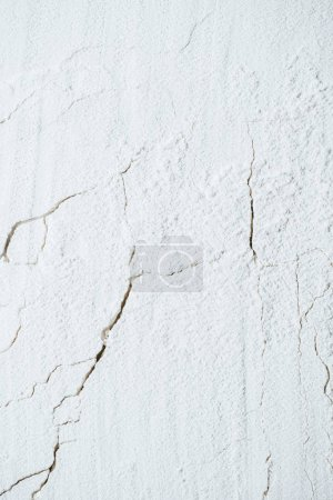 cracked background with white flour texture